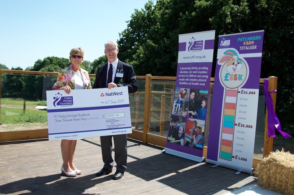 Richard hands cheque to Joan from Chailey heritage.jpg