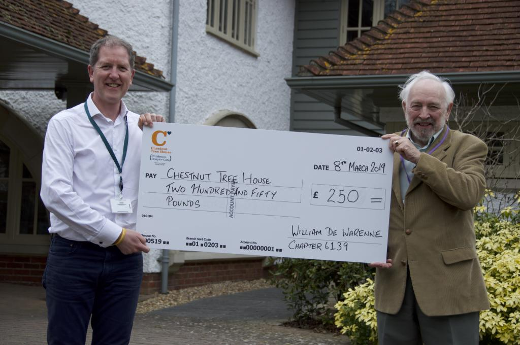 John presents cheque to martin close up.jpg